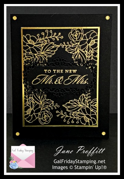 Gold embossing powder on a black card stock base creates an elegant look.