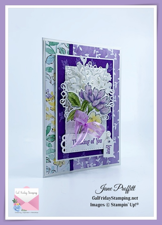 Lot's of layers adorn the front of this floral beauty in purples.